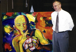 TPAC Assistant Director Mark Radziejeski with official 2005 Topeka Jazz Festival painting by a local Topeka artist. [Photo by Rich Hoover]