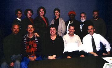 TPAC and BMF meet. Front row (from left) John Esau, development director; Mike Woodruff, operations assistant; Melanie Kitchner, marketing manager; Rob Seitz, executive director; Mark Radziejeski, assistant director. Back row (from left) Sarah Kratzer, finance manager; April Evans, box office manager; Pamela Hatfield, executive assistant; Christy Bien, receptionist; Grace Sankey Berman; Butch Berman; Tony Rager [Photo by Rich Hoover]