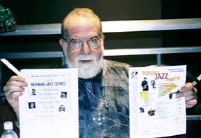 Butch Berman with flyers for Berman Jazz Series and 2005 Topeka Jazz Festival [Photo by Tony Rager]