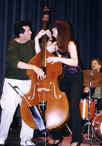 "Bassists Jim DeJulio and Jennifer ""Lefty"" Leitham fool around. [Photo by Tom Ineck]"