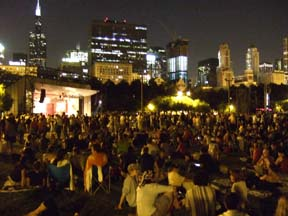 Chicago's skyline glows as a crowd gathers at Grant Park for an evening performance. [Photo by Tom Ineck]