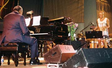Pianist Mulgrew Miller interacts with Bridgewater. [Photo by Tom Ineck]