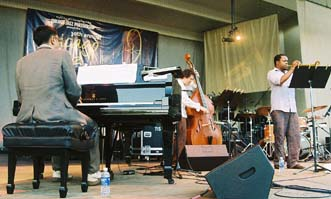 Pianist Vijay Iyer, bassist Stephan Crump and trumpeter Ambrose Akinmusire [Photo by Tom Ineck]